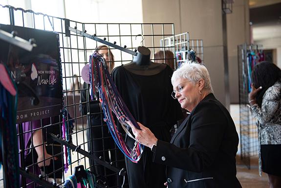 Carolyn Miller shops for a scarf in the Abi Ferrin Pop-Up Shop