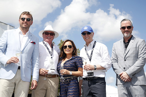 Left to right: Rolls-Royce Motor Cars NA president Martin Fritches; Dr. Doug & Molly Barnes; Park Place Dealerships chairman Ken Schnitzer; Park Place Premier Collection GM Heath Strayhan.