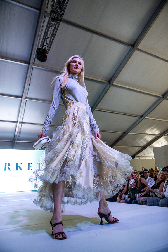 Jan Strimple produced the Highland Village Fashion Show on the Million Ait Stage in the Porsche Pavilion