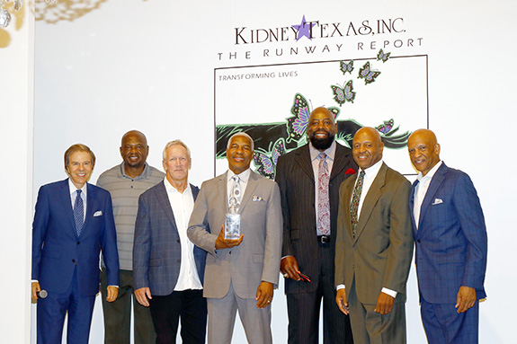 "Scott Murray, emcee on stage with former Dallas Cowboys players Michael Downs, Doug Donley, Everson Walls who was presented with the Inaugural Everson Walls Legacy Award; Ed ""Too Tall"" Jones, Timmy Newsome, and Drew Pearson"