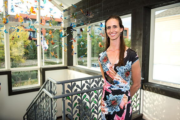 Designer Carlyn Ray with her butterfly installation