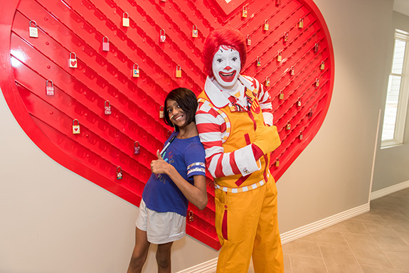 """RMHD House guest Swetha Prakash with Ronald McDonald in front of new """"lock"""" installation"""