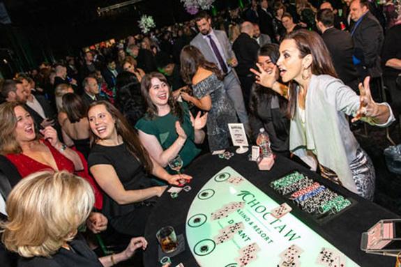 Dallas Stars In-Game host & National Anthem Singer Celena Rae deals blackjack