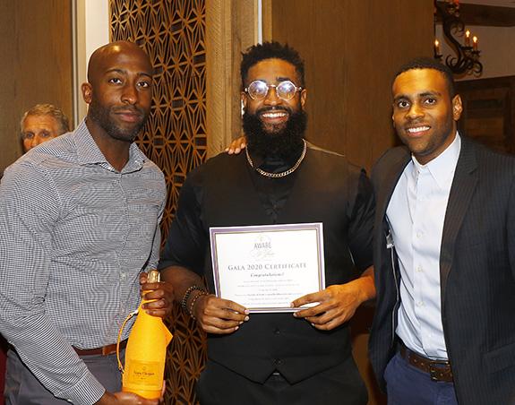 Ike Ndukwe, Xavier Alexander, and Aten Williams with raffle winnings
