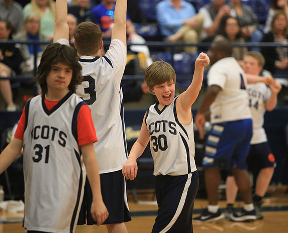 Miles Gill of the Highland Park white team points to the crowd after a crucial play.