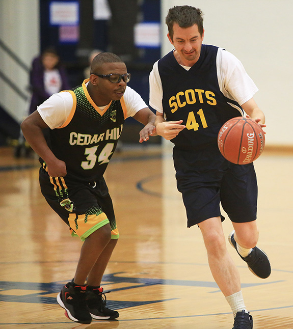 James Nix (41) of the Highland Park Blue Team drives the lane during the blue team's game