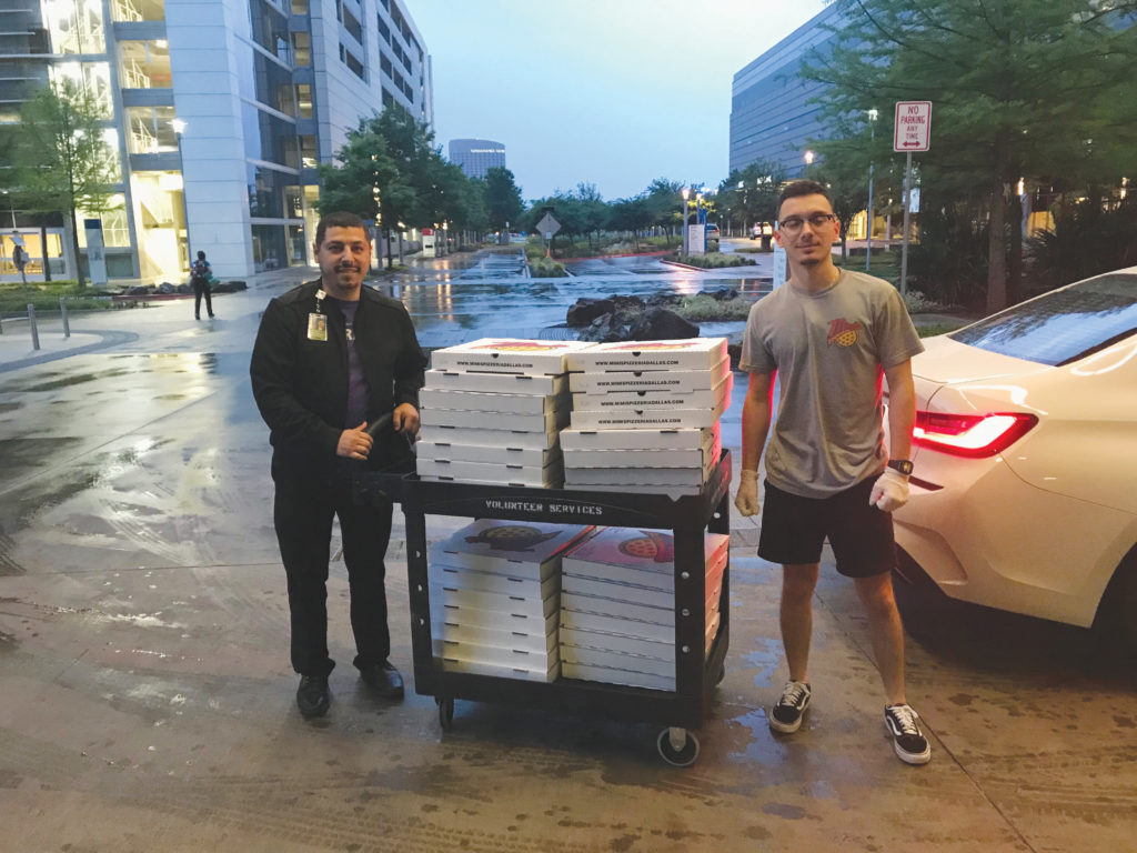 Workers for Mimi's Pizzeria deliver donated meals for hospital workers. (COURTESY PHOTO)