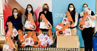 Young Cancer Patients Receive Cookies, Hats, Orange Ukuleles